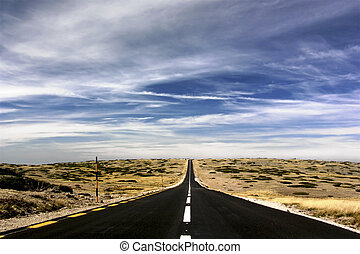 Going to nowhere - Landscape with a road ending on the...