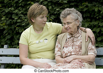mother & daughter - elderly woman with her daughter on the...
