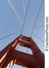 Golden Gate looking up to tower - The Golden Gate Bridge is...