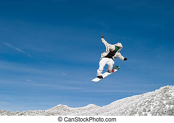 Snow Boarder High in the Air Zoom - snowboarder jumping