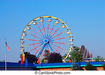 Amusement Park - Ferris wheel ride at an amusement park in...