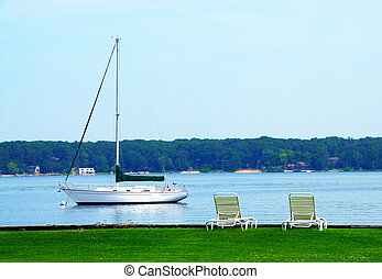 Sailboat anchored on White Lake in Michigan, USA in summer.