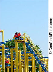 Colorful Roller Coaster - Roller coaster at an amusement...