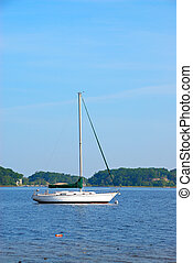 Sailboat anchored on White Lake in Michigan