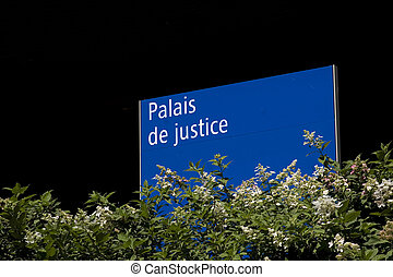 Palais de justice - A sign outside the Palais de justice, in...