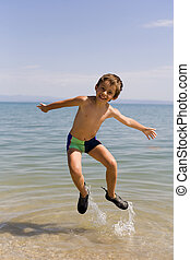 Child jump on seacoast