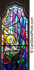 Stained Glass Window - A stained glass window featuring a...