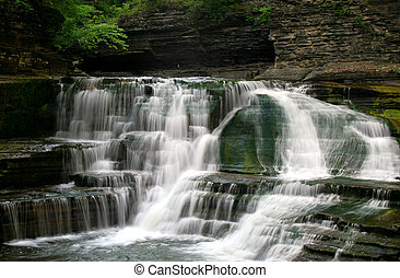 Waterfalls - Waterfall cascading over mossy rocks Robert H...