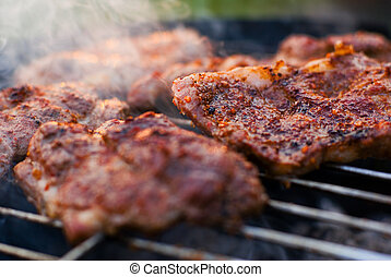 Roasted meat on the grill. - Delicious chuck steaks on the...