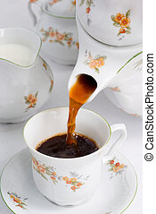 Pouring coffee or tea. - Pouring coffee (or tea) from...