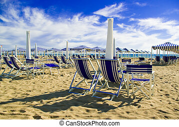 Viareggio\\\'s sandy beach, - Umbellas and seats in a...