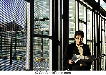 Reading businessman - A businessman reading financial...