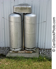 Gas Tanks or Cylinders - Pair of gas cylinders outside a...