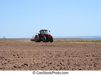 Tractor plowing land - Farmer working on him tractor plowing...