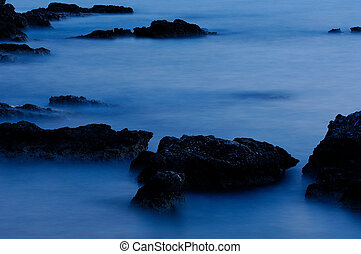 Rocks in blue - Picture of sea rocks at low light