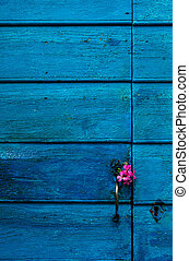 Message of love - Image shows a highly textured blue door...