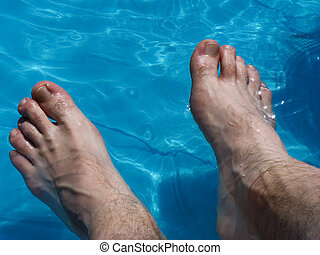 Wet Feet - Mens hairy feet cooling off in water