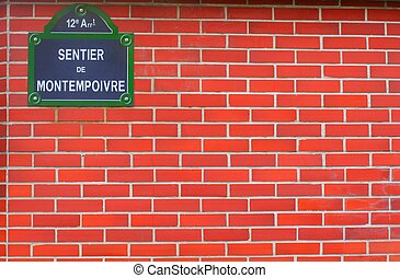 Parisian bricks wall - Bricks wall with Paris street name