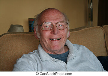 mature man with a happy face as relaxes indoors