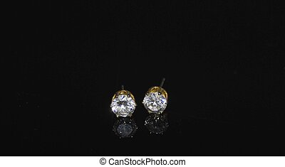 diamond earings - diamond earrings on black background