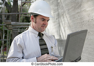 Construction Engineer with Laptop - A construction engineer...
