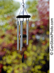 Wind Chimes - A metal wind chimes against a nature back...