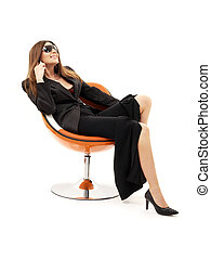 businesswoman with phone in orange chair over white