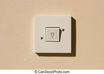 traditional electrical switch on the wall