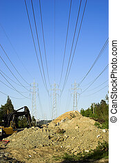 Power Lines Construc - Three power masts supporting high...