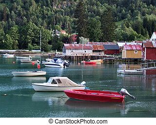 Boats in harbor and calm water - Harbor in Norwegian fjord -...