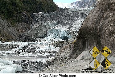Dangerous place - Face of Franz Josef Glacier, New Zealand;...