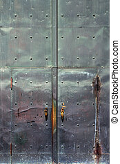 Metal doors - Corroding metal doors of a church. Door...