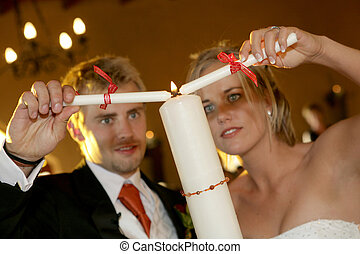 Candle Ceremony - A bride and groom lighting a candle