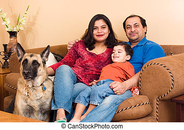 East Indian Couple with their son and dog