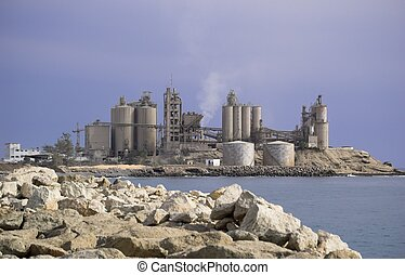 Cement Factory - A cement factory, located on the coast,...