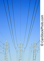 Power Lines - Three power masts with power lines stretching...