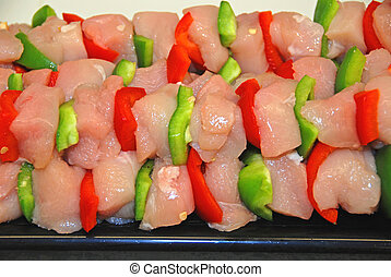 chicken kabobs - fresh cubed chickenpeppers on a skewer