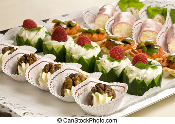 Antipasto - Small snacks on a plate ready to be served at...