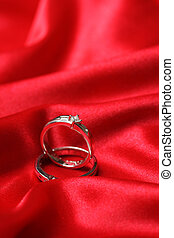 Wedding rings - A pair of wedding rings on a red fabric