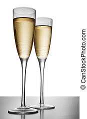 Elegant Champagne - Two elegant champagne glasses on a dark...