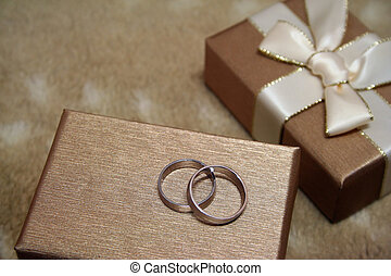 Marriage Proposal - A pair of platinum wedding rings atop an...