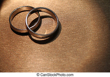 Wedding Rings - A pair of wedding bands against a...