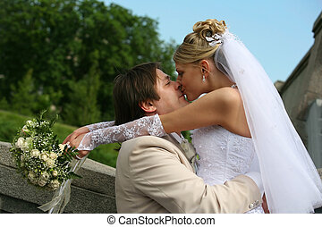 Newly married pair - Recently married pair has kissed in...