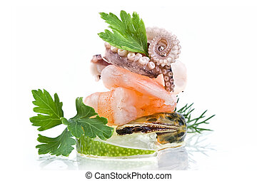 Seafood-mussels,octopus,shrimp decoraded with greens and...