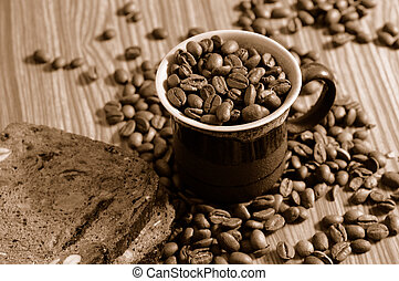 Coffee time - Coffee beans and rye toast on tabletop