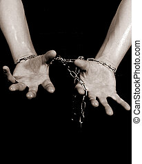 Chained Hands - 2 hands chained together in black and white.