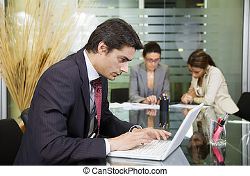 People at work: businessman working with laptop during a...