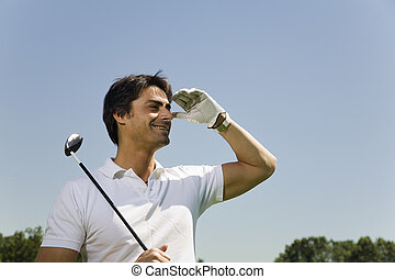 Golf club: golfer searching for the ball