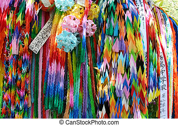 In Memory - origami cranes left outside of wartime caves in...