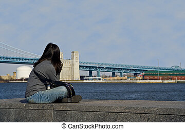 Deep Thought - A young lady looking out over the river